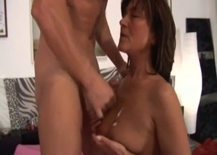 Tanned mommy has to take a cumshot