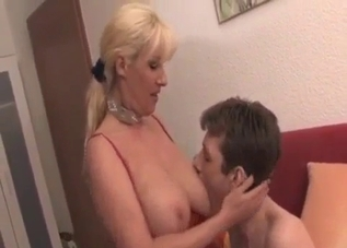 Dress-wearing blonde sucking a massive cock