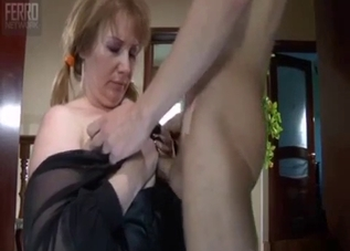 Blonde in black sucking son's cock