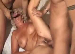 Tanned mommy gets spit-roasted by the family